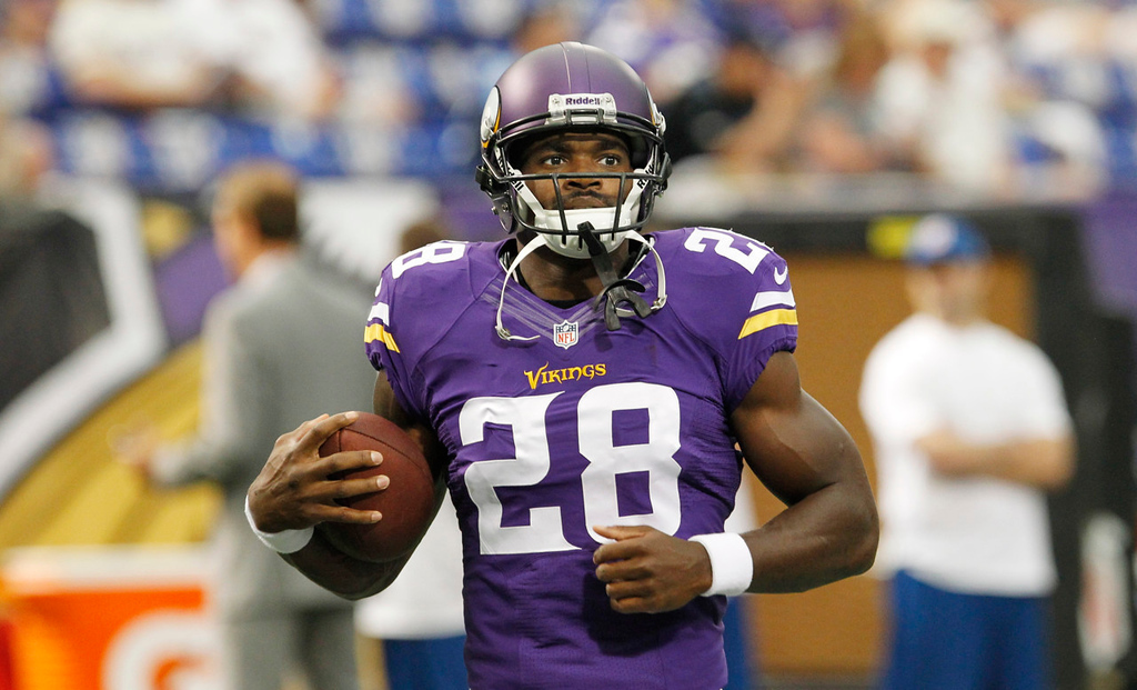 . Vikings running back Adrian Peterson warms up before Minnesota\'sl game against the Titans. (AP Photo/Ann Heisenfelt)