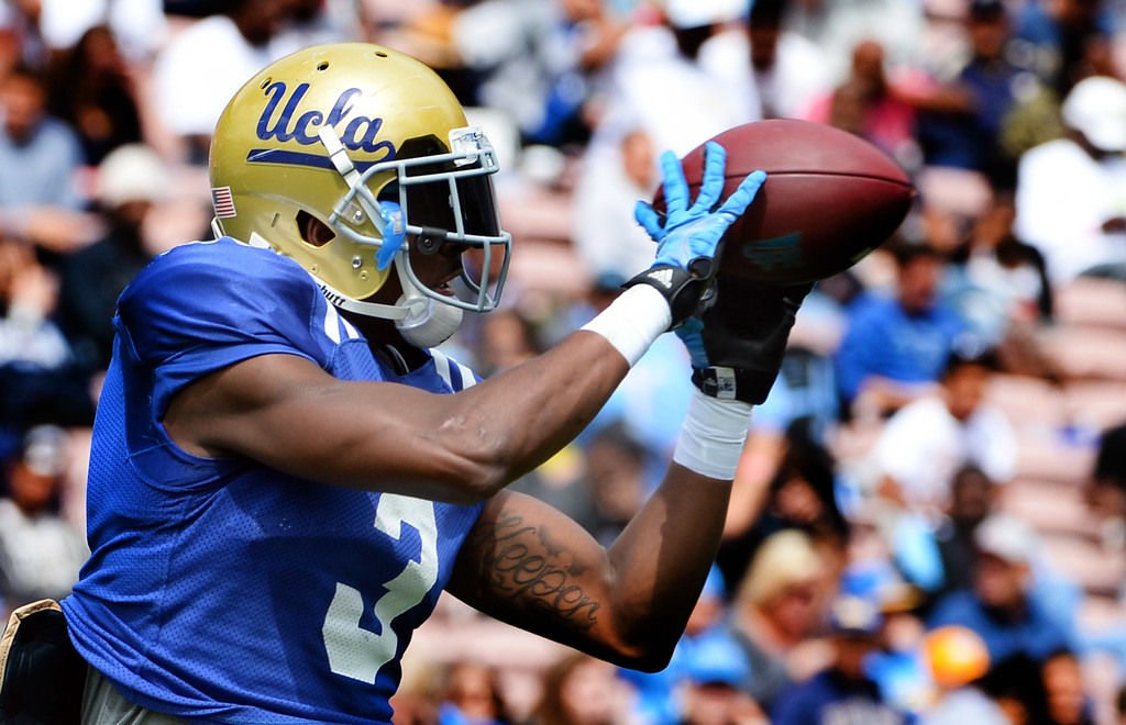 . UCLA Bruins wide receiver Jordan Lasley catches a pass during a NCAA college spring football game at the Rose Bowl in Pasadena, Calif., Saturday, April 25, 2015.
