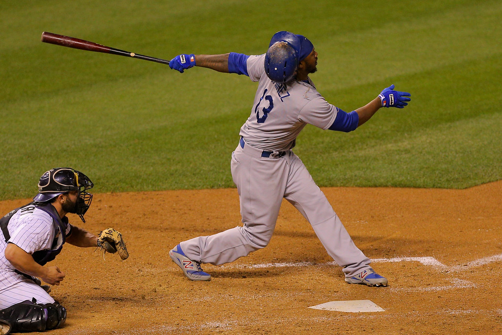 . DENVER, CO - SEPTEMBER 16:  Hanley Ramirez #13 of the Los Angeles Dodgers loses his helmet while striking out during the sixth inning against the Colorado Rockies at Coors Field on September 16, 2014 in Denver, Colorado. (Photo by Justin Edmonds/Getty Images)