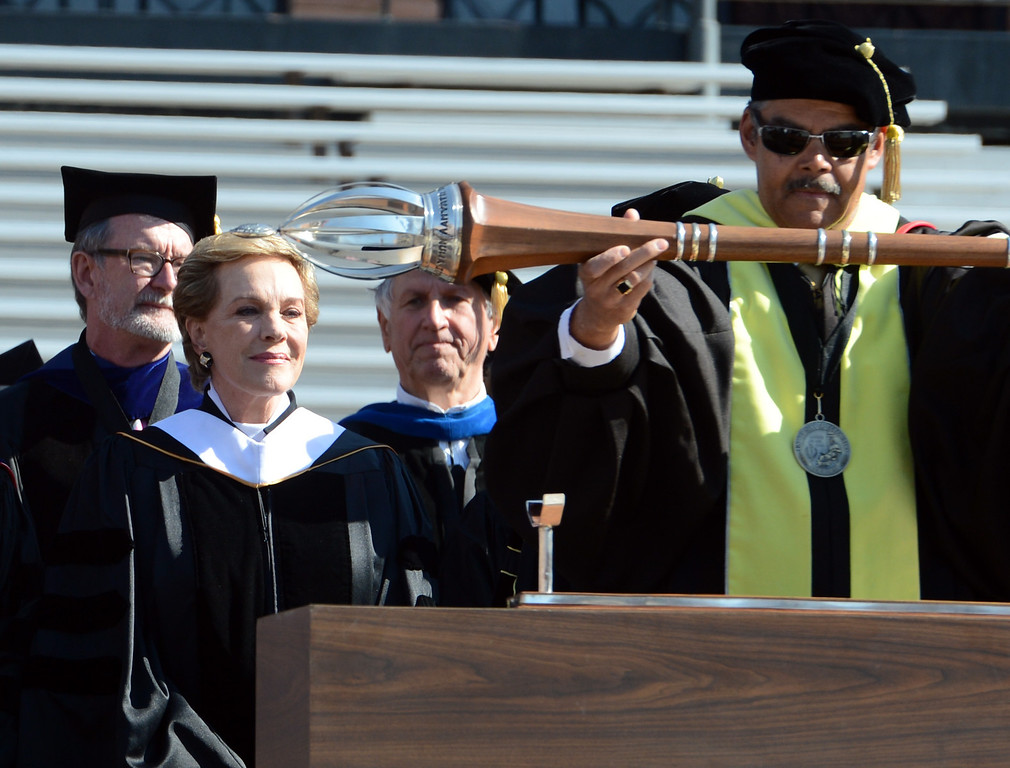 . Julie Andrews, left, watches Dean James Williams lower the scepter at the beginning of the commencement ceremony at the University of Colorado-Boulder 2013 Spring Commencement at Folsom Field, in Boulder, Colo., on Friday, May 10, 2013. Andrews, 77, delivered the commencement address to more than 6,000 graduates on Friday. (AP Photo/Daily Camera, Cliff Grassmick)