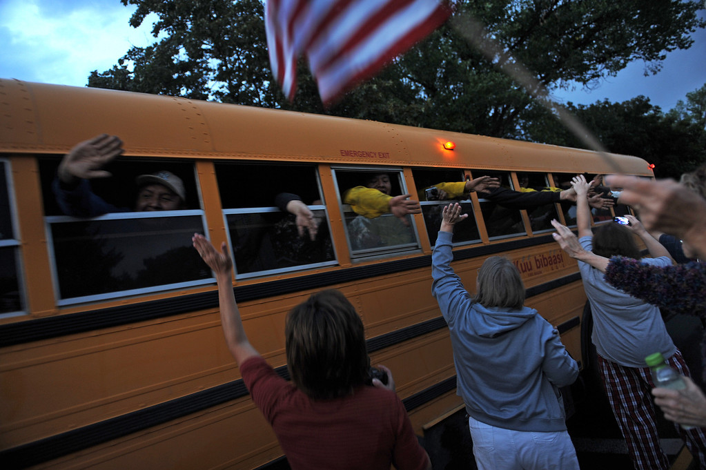 . Colorado Springs residents high five returning crews as they make their way up Fontanero Street on their way back to fire camp today July  3, 2012. Residents of the Colorado Springs community turn out each night at the intersections of Fontanero and 31st streets in downtown Colorado Springs to show their appreciation for the firefighters coming off the fire line. Helen H. Richardson, The Denver Post