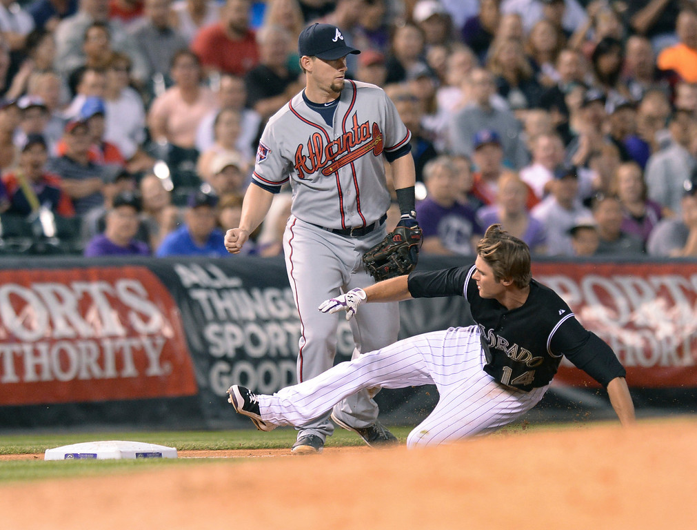 . Colorado\'s Josh Rutledge slid safely into third base with a triple in the fifth inning. The Colorado Rockies hosted the Atlanta Braves Tuesday night, June 10, 2014. (Photo by Karl Gehring/The Denver Post)