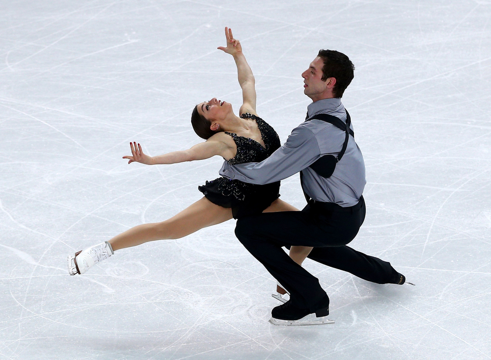 . Marissa Castelli and Simon Shnapir of the United States compete in the Figure Skating Pairs Free Skating during day five of the 2014 Sochi Olympics at Iceberg Skating Palace on February 12, 2014 in Sochi, Russia.  (Photo by Clive Mason/Getty Images)