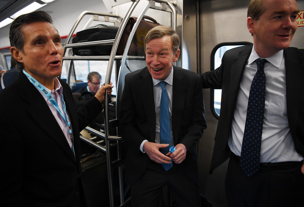 . U.S. From left, former Denver Mayor Federico Peña, Governor of Colorado John Hickenlooper, and Senator for Colorado Michael Bennet look out the train windows at a station named after Peña as they ride the new University of Colorado A-Line, April 22, 2016. The line from Union Station to Denver International Airport opened for commuters at noon. (Photo by RJ Sangosti/The Denver Post)