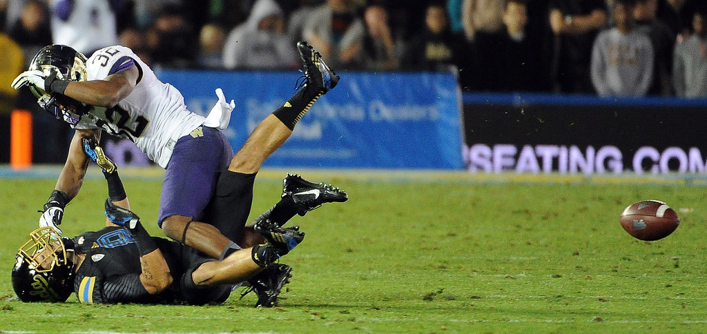 . Washington Huskies defensive back Tre Watson (32) knocks away pass intended for wide receiver Jalen Ortiz (8) during the first half of their college football game in the Rose Bowl in Pasadena, Calif., on Friday, Nov. 15, 2013.  UCLA won 41-31.   (Keith Birmingham Pasadena Star-News)