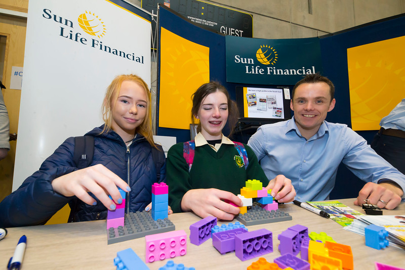 "09/11/2017. Crystal Valley Tech Showcase at WIT Arena. Pictured are Shane Corbett from Sunlife Financial with Sophie Fitzgerald and Therese Kehoe from St Mary's Secondary School, New Ross Co. Wexford. Picture: Patrick Browne  Event demonstrates Tech and ICT is thriving in Wexford and the South East 50 companies and 2,000 students, industry and recruiters attend the inaugural Crystal Valley Tech Showcase event  Over 50 companies who are working together as Crystal Valley Tech showcased their rapidly growing industry in the WIT Arena on Thursday morning to approx. 2,000 members of the public, college and second level students, recruiters, government agencies and other industry.  The future is bright for ICT in the South East according to Dr Padraig Kirwan, Head of the Department of Computing & Mathematics at Waterford Institute of Technology. ""Computing is thriving in the South East judging by the number and diversity of ICT companies here today. Even more encouraging is the number of second level students who attended from Waterford, Kilkenny, Carlow, Tipperary and Wexford and how interested they are about the career opportunities in this exciting industry.""  Wexford schools attending the event included St. Mary's CBS in Enniscorthy, St Mary's Secondary School in New Ross and Colaiste an Atha in Kilmuckridge.  Elaine Fennelly, Bluefin Payment Systems General Manager and co-founder of Crystal Valley Tech is very excited about the industry in the South East and today's showcase event. ""People who work in the industry already know that Tech is well established in the South East and the number of opportunities and companies continues to grow and grow. According to a recent Tech Ireland report there are over 60 indigenous and multinational companies employing well over 1,500 people from their bases in Waterford, Wexford, Kilkenny and Carlow.  ""However, we weren't so sure that people in the region realised just how big the ICT industry is becoming and to en"