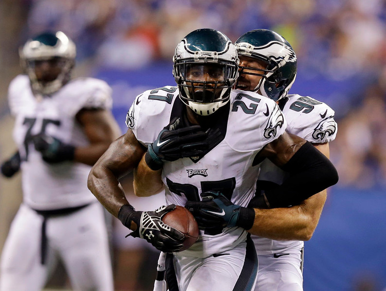 . Philadelphia Eagles free safety Malcolm Jenkins (27) celebrates with Connor Barwin (98) after Jenkins made an interception during the second half of an NFL football game against the Indianapolis Colts Monday, Sept. 15, 2014, in Indianapolis. (AP Photo/Michael Conroy)