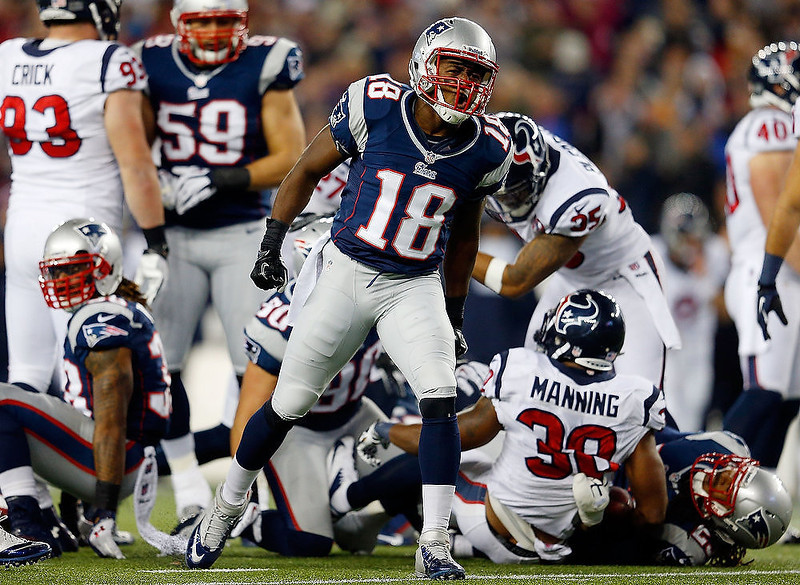 . Matthew Slater #18 of the New England Patriots reacts after a tackle against the Houston Texans during the 2013 AFC Divisional Playoffs game at Gillette Stadium on January 13, 2013 in Foxboro, Massachusetts.  (Photo by Jim Rogash/Getty Images)