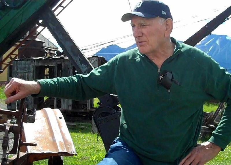 Grandpa with Muskegon tractor.jpg