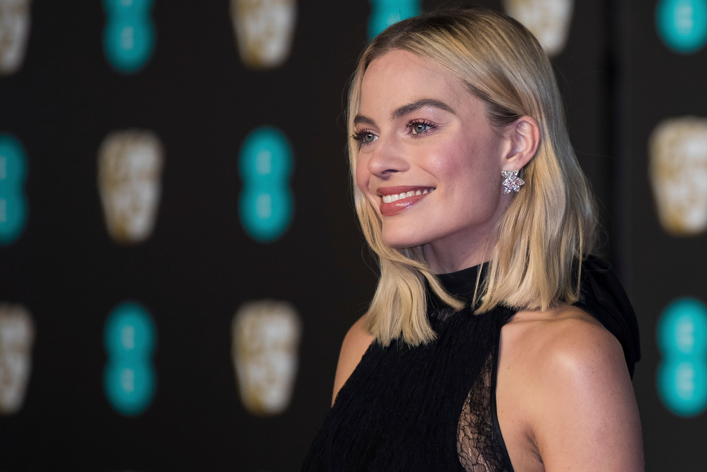 . Margot Robbie poses for photographers upon arrival at the BAFTA Film Awards, in London, Sunday, Feb. 18, 2018. (Photo by Vianney Le Caer/Invision/AP)