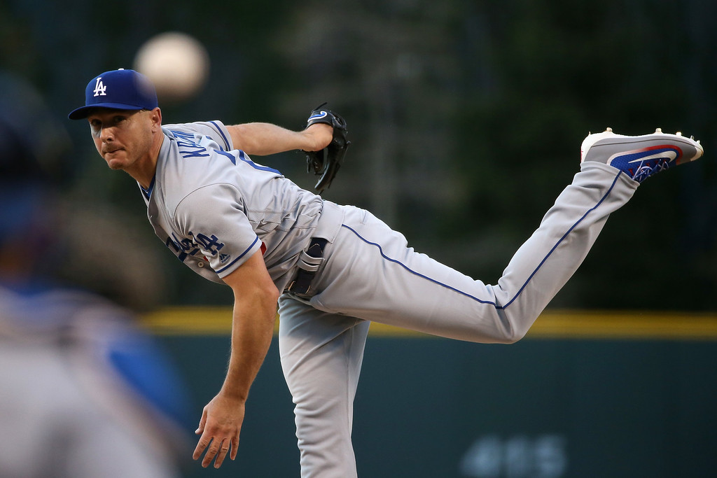 . DENVER, CO - APRIL 22:  Starting pitcher Scott Kazmir #29 of the Los Angeles Dodgers delivers against the Colorado Rockies at Coors Field on April 22, 2016 in Denver, Colorado.  (Photo by Doug Pensinger/Getty Images)