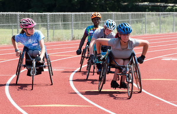08/08/19 Wesley Bunnell | Staff Helen Newman, L, and Stephanie Marquez along with teammates take several practice laps prior to the track and field event at the Hospital for Special Care's Ivan Lendl Adaptive Sports Camp at Berlin High School on Thursday August 9, 2019.