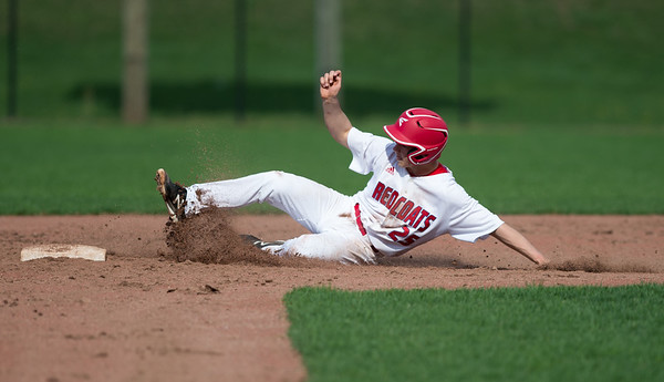 04/23/19 Wesley Bunnell | Staff Berlin baseball defeated Sheehan 7-6 at Sage Park on Tuesday afternoon. Daniel Veleas (25) slides safely into second base.