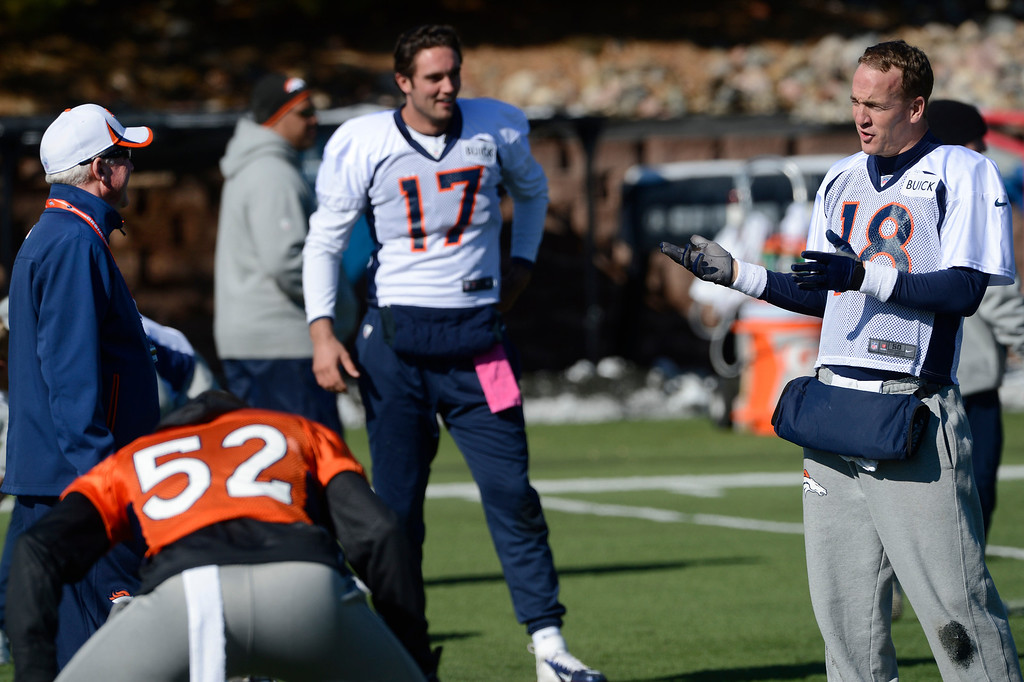 . Denver Broncos QB, Payton Manning, right, has a laugh with head coach, John Fox, left, during practice Friday morning, October 18, 2103. Backup QB, Brock Osweiler, center, listens. (Photo By Andy Cross/The Denver Post)