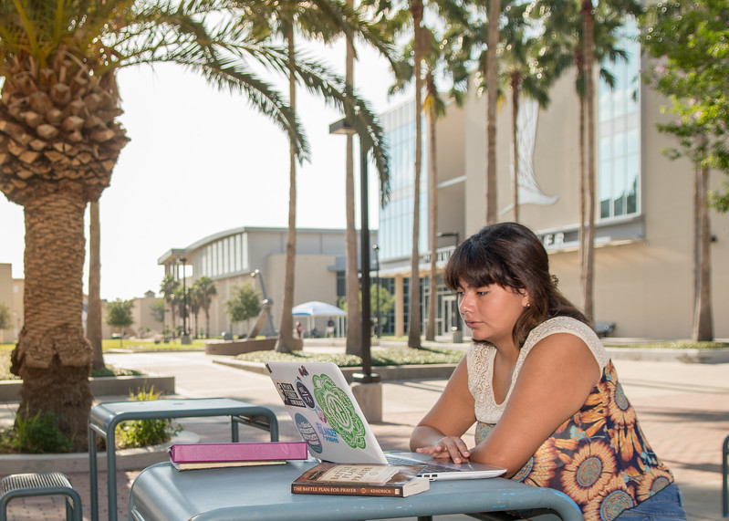 Yasmin Perez catches up on her psychology studies in front of the University Center.