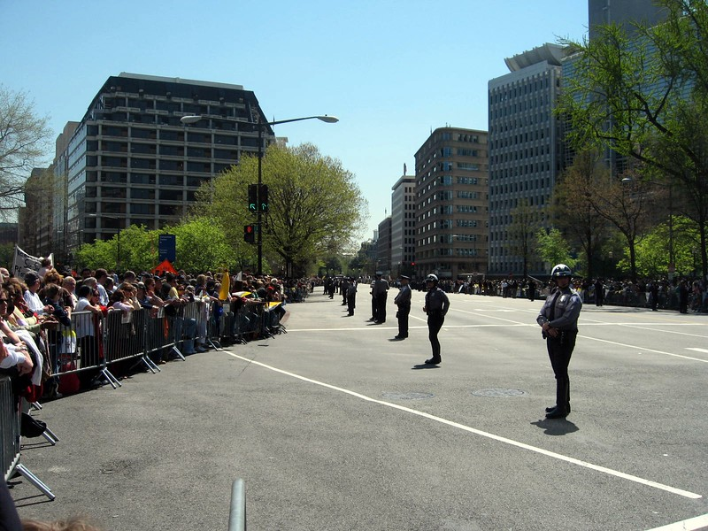Officers from the Alexandria Police Department help control crowds lining Pennsylvania Avenue to see the popemobile route from the White House to the Embassy of the Apostolic Nunciature of the Holy See
