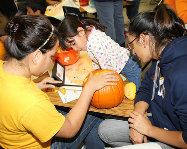 Volleyball team carving pumpkins at Roosevelt