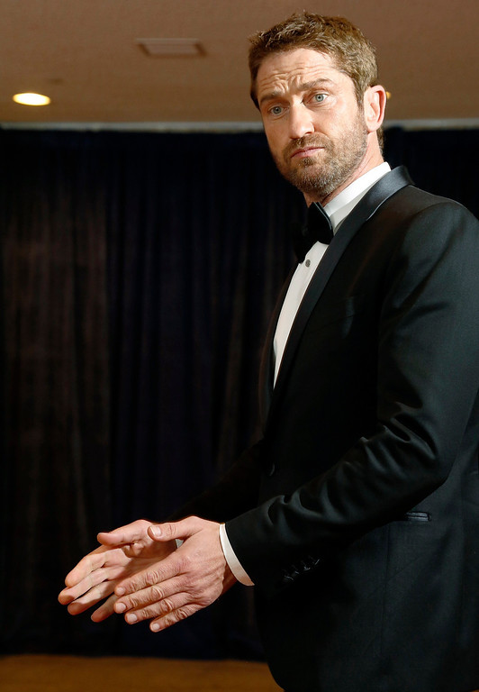 . Actor Gerard Butler walks on the red carpet at the annual White House Correspondents\' Association dinner in Washington April 27, 2013. REUTERS/Jonathan Ernst