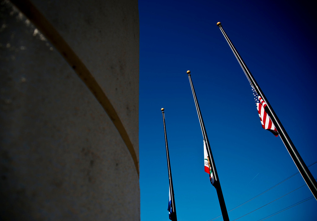 . Flags are lowered to half-staff in honor of the dead San Bernardino sheriff\'s deputy at Sheriff\'s Headquarters on Wednesday, Feb. 13, 2013. The deputy was killed during a shootout with ex-LAPD officer Christopher Dorner in Big Bear yesterday.  (SGVN/Staff photo by Watchara Phomicinda)