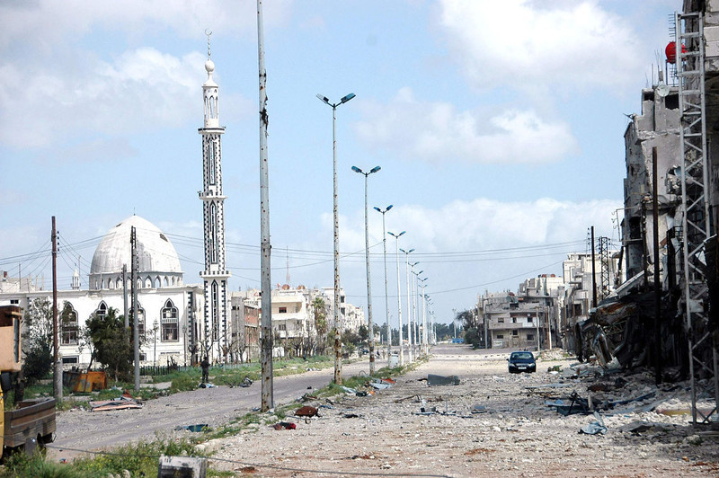 . A view is seen of a damaged building and mosque at Baba Amro neighborhood in Homs city, after clashes between forces loyal to Syrian President Bashar al-Assad and fighters of the Free Syrian Army, is seen in this handout photograph distributed by Syria\'s national news agency SANA on March 27, 2013. REUTERS/SANA