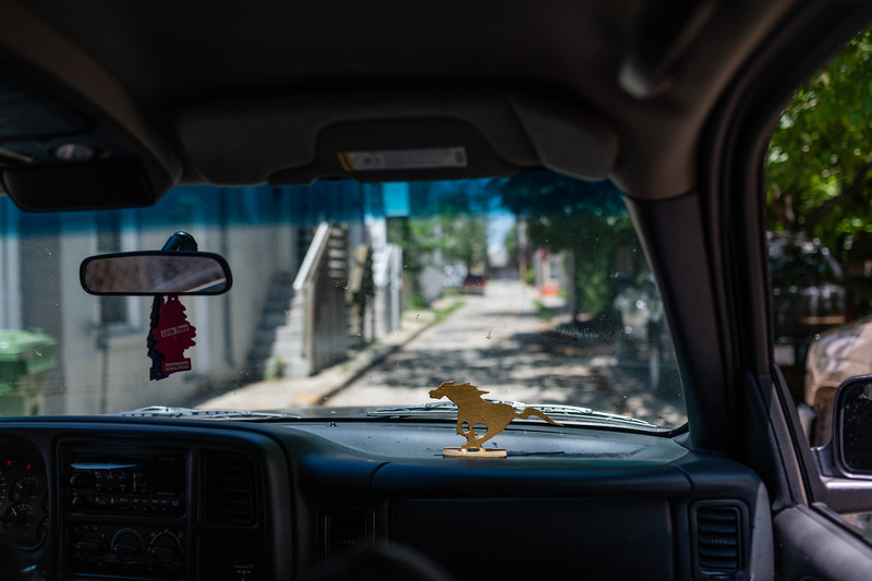 A horse statue sits on the dashboard in the stable's truck in Baltimore, Md. on May 26, 2020.