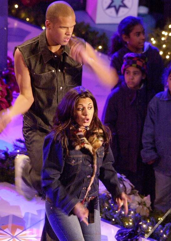 ". Actress Jamie-Lynn Sigler of HBO\'s series ""The Sopranos\""  performs during the annual Rockefeller Center Christmas tree lighting ceremony Wednesday, Nov. 28, 2001, in New York. (AP Photo/Mark Lennihan)"