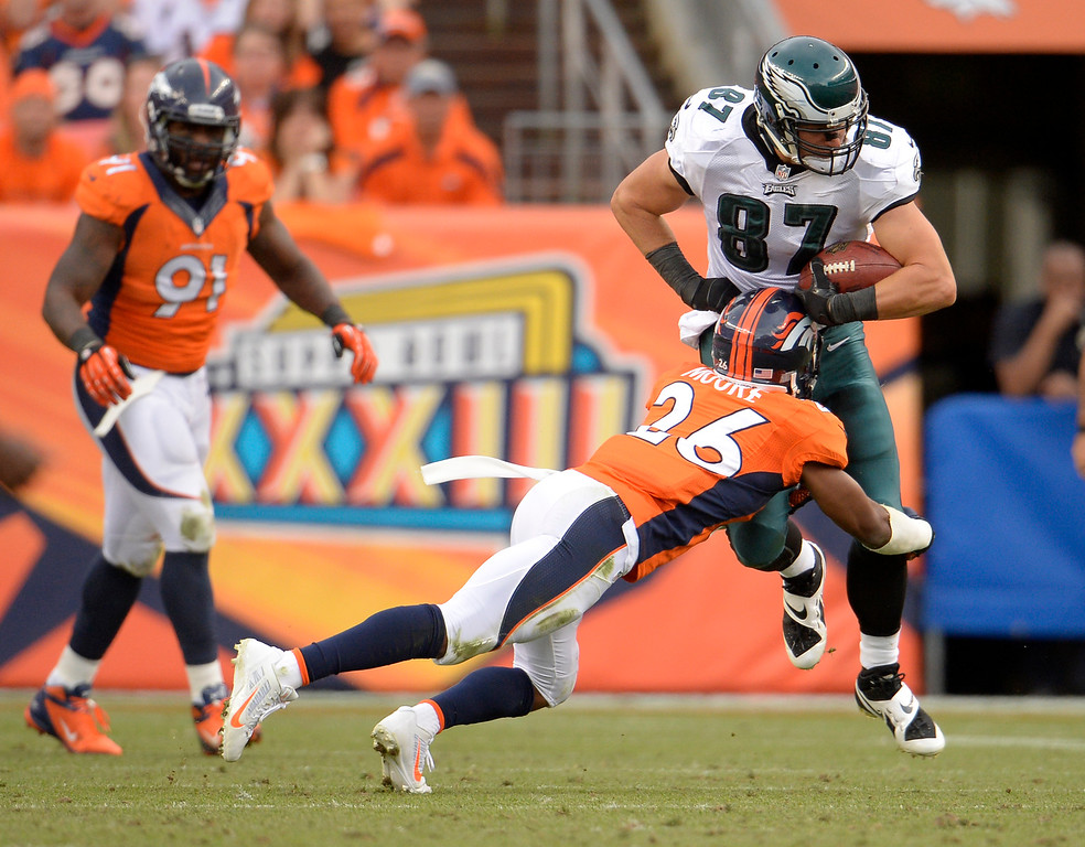 . Denver Broncos free safety Rahim Moore (26) hits Philadelphia Eagles tight end Brent Celek (87) during the fourth quarter. The Denver Broncos took on the Philadelphia Eagles at Sports Authority Field at Mile High in Denver on September 29, 2013. (Photo by Joe Amon/The Denver Post)