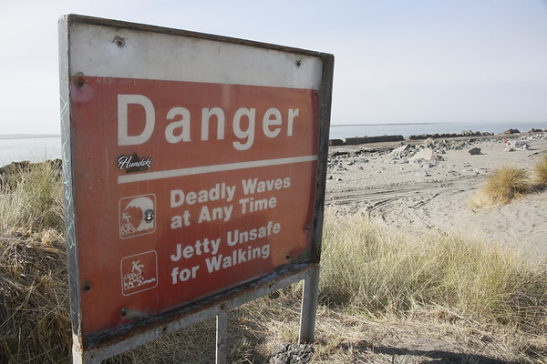 Photos: North Jetty death memorial and warning signage