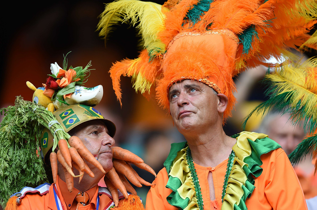 . Fans of the Netherlands look on before a Group B football match between Spain and the Netherlands at the Fonte Nova Arena in Salvador during the 2014 FIFA World Cup on June 13, 2014.  AFP PHOTO / JAVIER SORIANO/AFP/Getty Images
