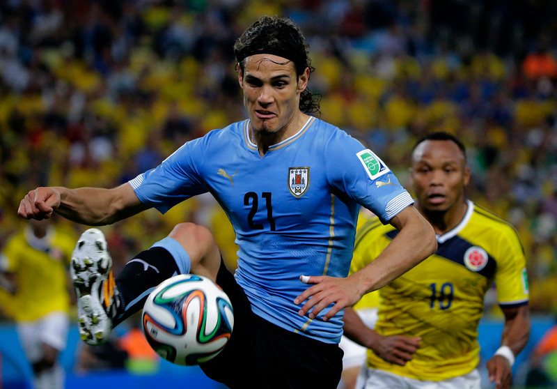 . Uruguay\'s Edinson Cavani controls the ball during the World Cup round of 16 soccer match between Colombia and Uruguay at the Maracana Stadium in Rio de Janeiro, Brazil, Saturday, June 28, 2014. (AP Photo/Sergei Grits)