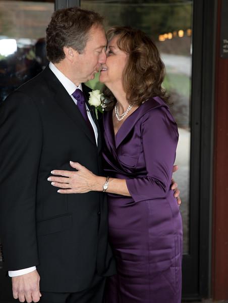 Kissing in front of glass door.jpg