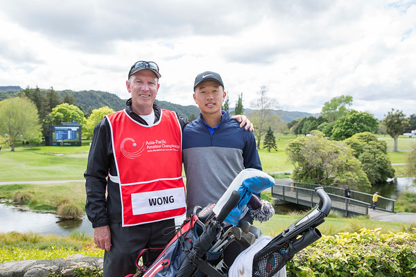 Shuai-ming Wong from Hong Kong and his caddie Tony Houpt immediately after scoring a course record 5 under 65 on the 2nd day of competition  in the Asia-Pacific Amateur Championship tournament 2017 held at Royal Wellington Golf Club, in Heretaunga, Upper Hutt, New Zealand from 26 - 29 October 2017. Copyright John Mathews 2017.   www.megasportmedia.co.nz