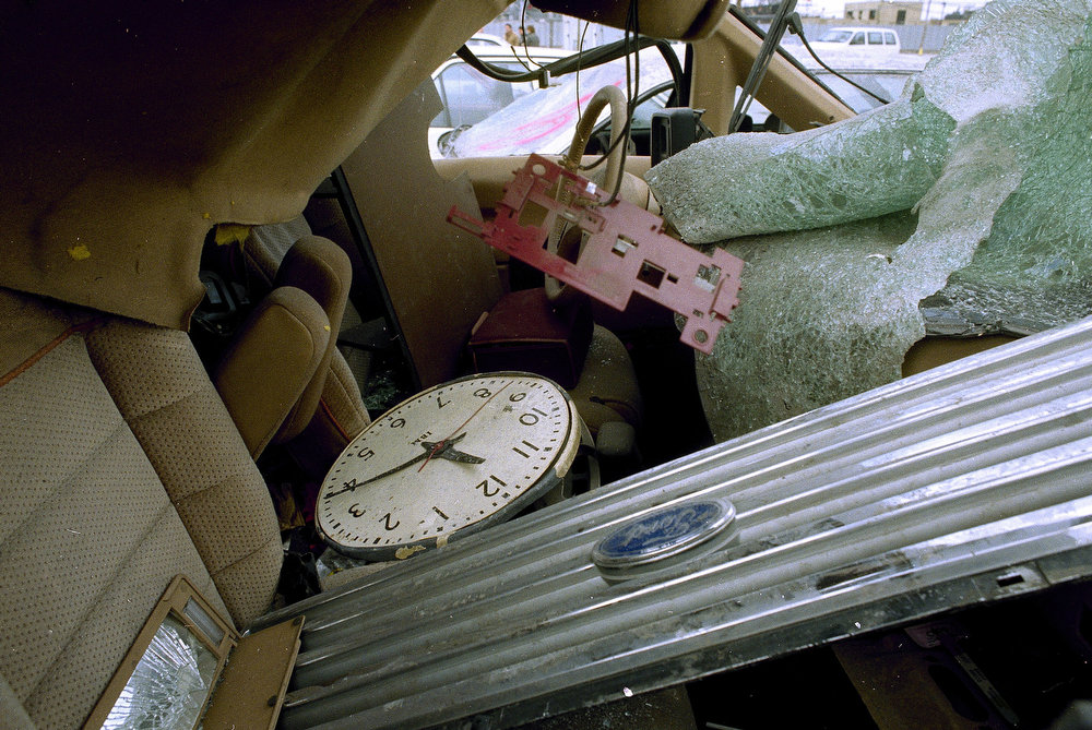 Description of . A clock, which reflects the time of the blast at the World Trade Center, sits in the wreckage of a vehicle at an impound lot in Brooklyn, March 9, 1993. (AP Photo/Kevin Larkin)