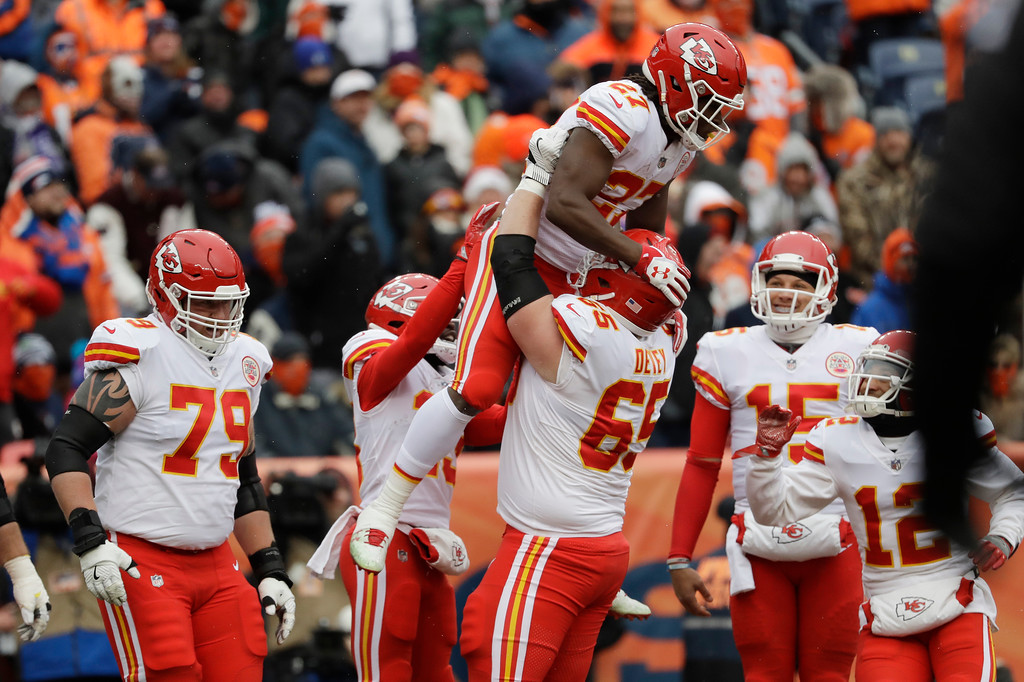 . Kansas City Chiefs running back Kareem Hunt, top, is lifted by teammate Jordan Devey after Hunt\'s rushing touchdown against the Denver Broncos during the first half of an NFL football game Sunday, Dec. 31, 2017, in Denver. (AP Photo/Jack Dempsey)