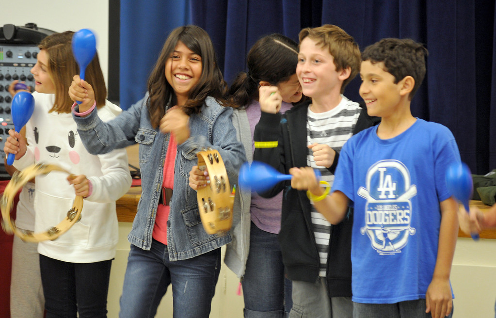 . Students play along as Country Western singer Lizzie Sider, 15, sings during her 80-school California Bully Prevention Tour for students at Ocean View Elementary School in Whittier on Monday November 4, 2013. (Whittier Daily News/Staff Photo by Keith Durflinger)