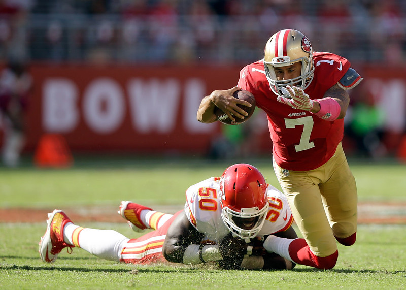 . Colin Kaepernick #7 of the San Francisco 49ers is tackled by Justin Houston #50 of the Kansas City Chiefs at Levi\'s Stadium on October 5, 2014 in Santa Clara, California.  (Photo by Ezra Shaw/Getty Images)