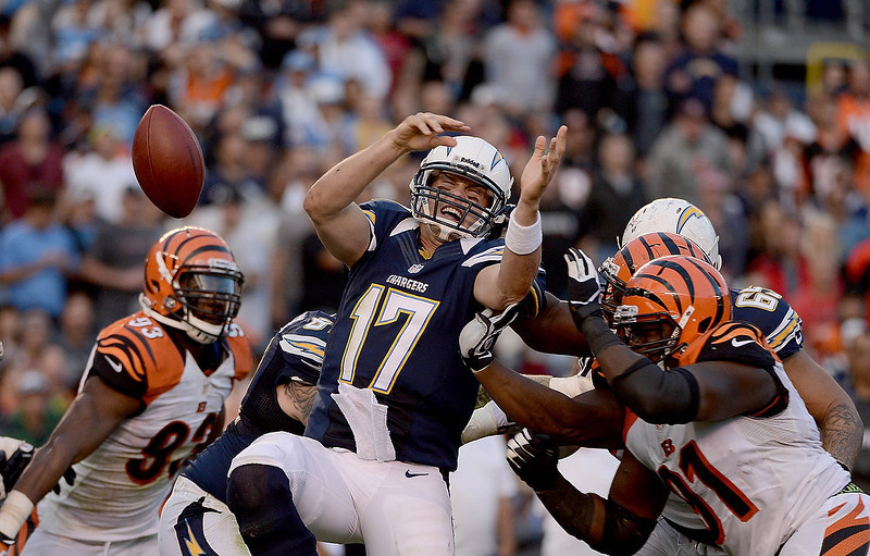 . Philip Rivers #17 of the San Diego Chargers fumbles the ball against the Cincinnati Bengals on December 2, 2012 at Qualcomm Stadium in San Diego, California. (Photo by Donald Miralle/Getty Images)