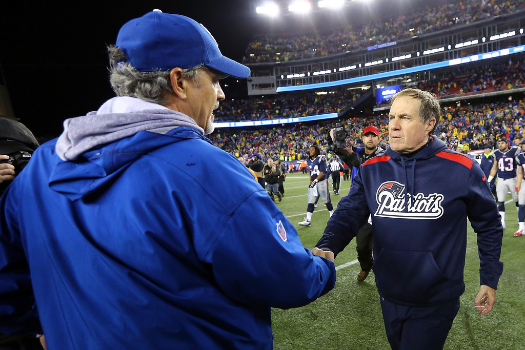 . FOXBORO, MA - JANUARY 11:  (L-R) Head coach Chuck Pagano of the Indianapolis Colts shakes hands with head coach Bill Belichick of the New England Patriots after their AFC Divisional Playoff game at Gillette Stadium on January 11, 2014 in Foxboro, Massachusetts. The New England Patriots defeated the Indianapolis Colts 43 to 22.  (Photo by Al Bello/Getty Images)