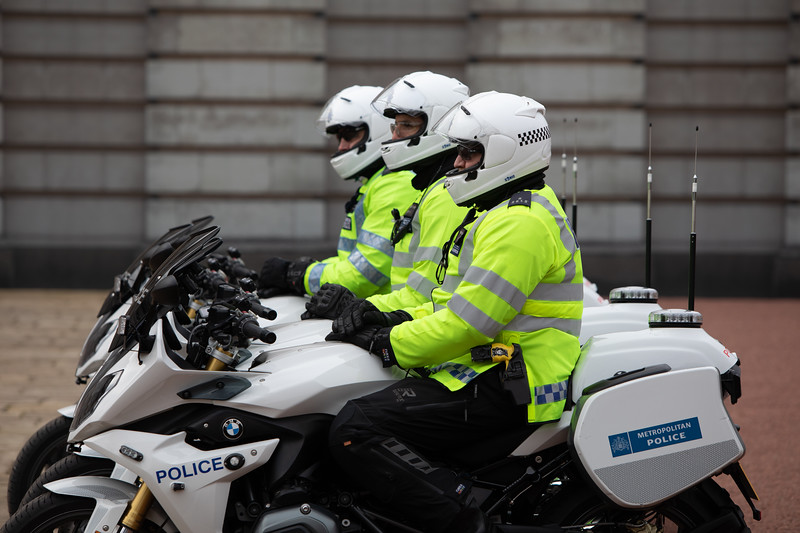 Modern police watching the Buckingham courtyard.