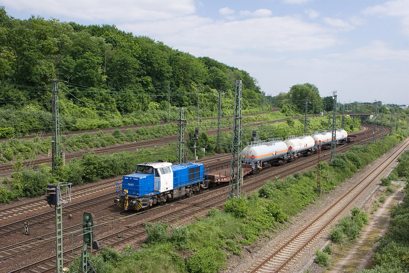 HGK regularly operates a semi-famous (in the area, anyway) hazmat train of hydrogen cyanide. Special idler cars are employed at each end. Here it passes through the flyovers close to Mediapark. This location offers nice views and is located just a short walk north of Köln West.