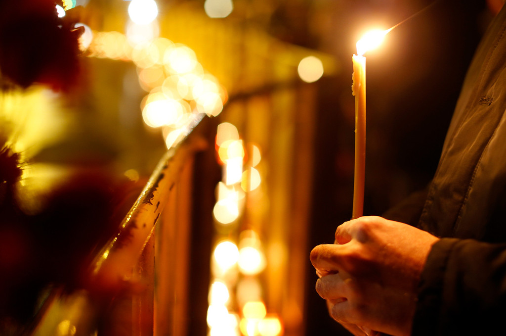 . People lay flowers and light candles in front of the Maxima supermarket in Riga, Friday, Nov. 22, 2013.   (AP Photo/Mindaugas Kulbis)