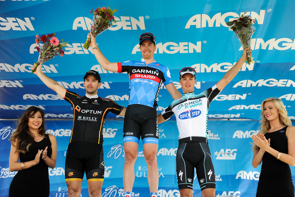 . Stage 4 winner Tyler Farrar, center, stands with second-place finisher Ken Hanson, left, and third-place winner Gianni Meersman at the Amgen Tour of California finish in Santa Barbara, Wednesday, May 15, 2013. (Michael Owen Baker/Staff Photographer)
