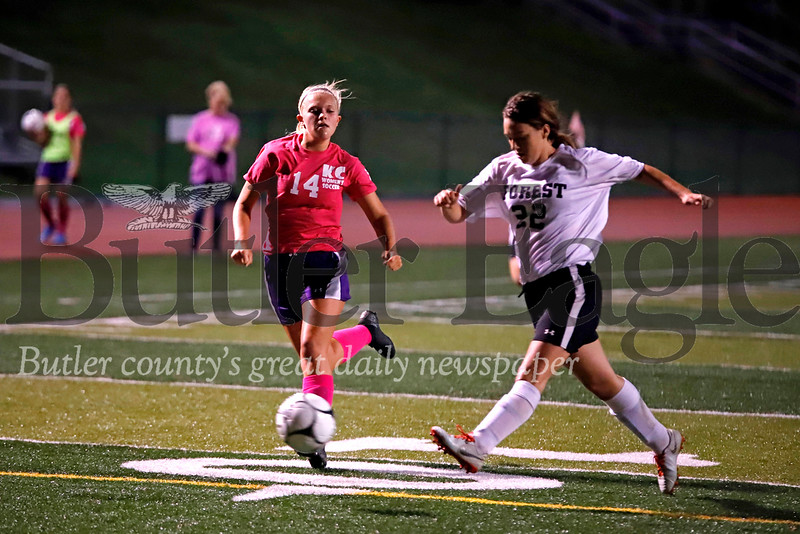 Karns City's Brooke Stahlman races to challenge Forest's Faythlynn Vanek for the ball. Stahlman scored a goal in the Thursday home win.