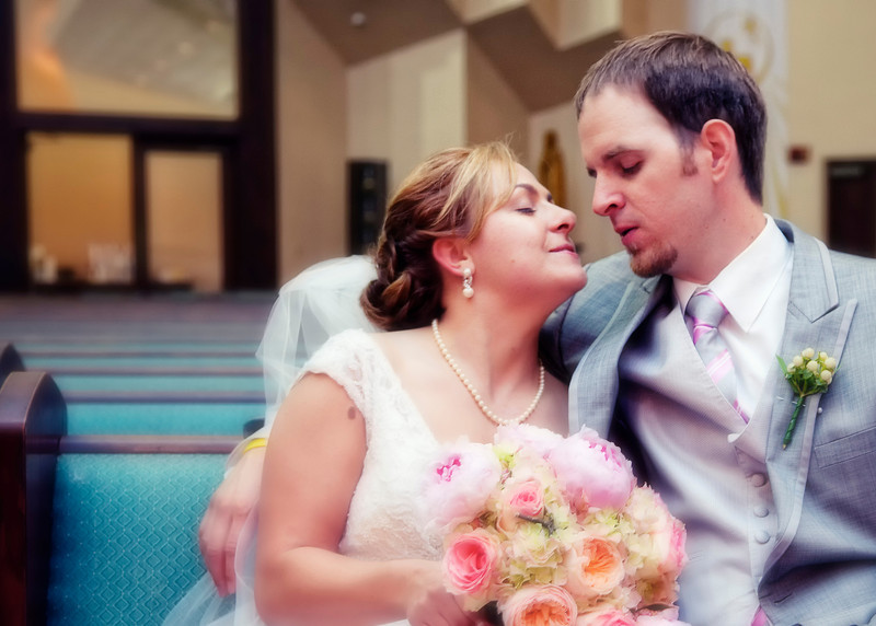 Bride and Groom About to kiss in church pew.jpg