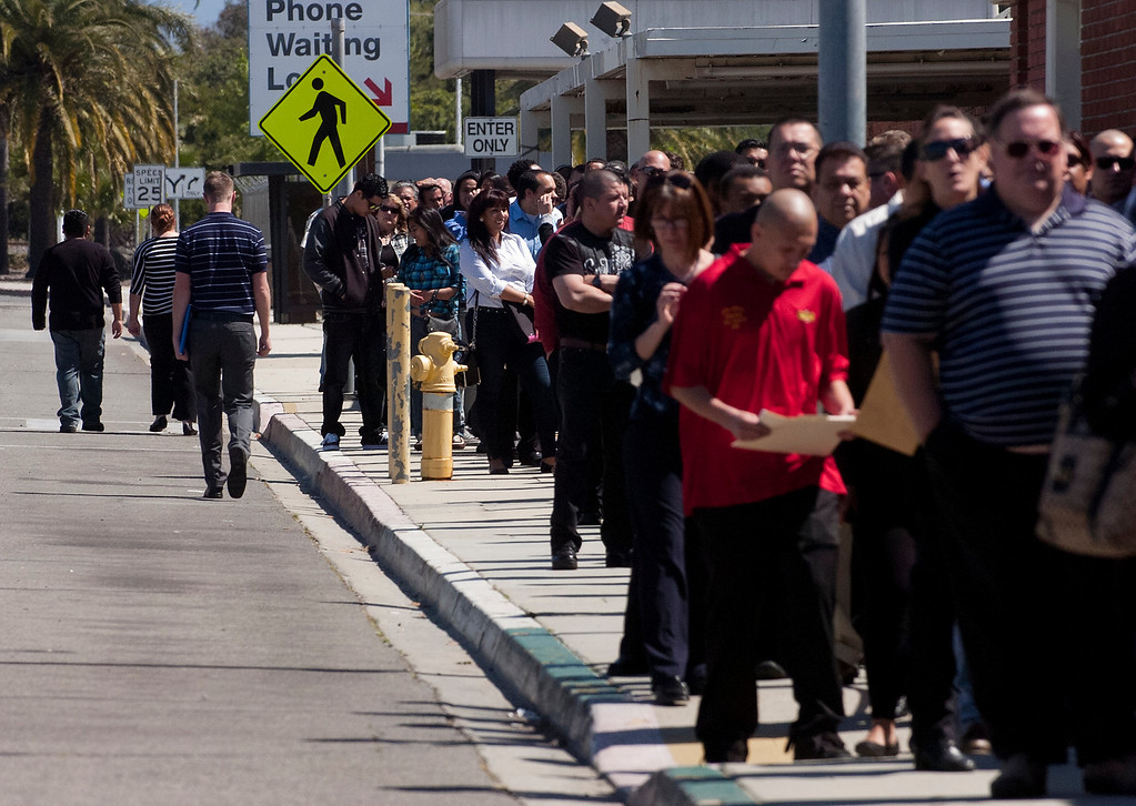 . 0418_NWS_IDB_L-JOBFAIR-03-JCM (Jennifer Cappuccio Maher/Staff Photographer) Job seekers stand in line for the San Bernardino County Workforce Investment Board\'s West End Spring Job Fair Wednesday, April 17, 2013, at LA/Ontario International Airport in Ontario.