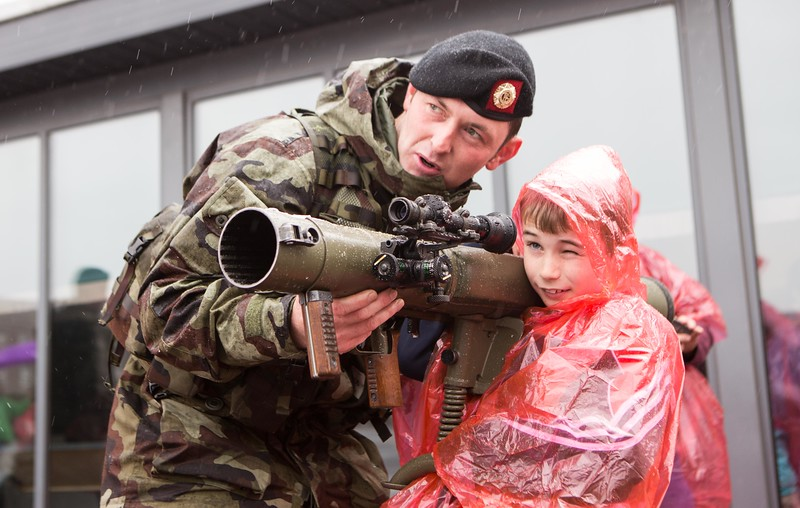 Cut Lougheed from the Defence Forces demonstrating a weapon to Colm Buckley during the VIP visit for sick children from the Mercy Hospital to Collins Barracks, hosted by the Irish Army as part of the Mercy Heroes campaign in aid of The Mercy Cancer Appeal on Friday, October 14th Pic Darragh Kane