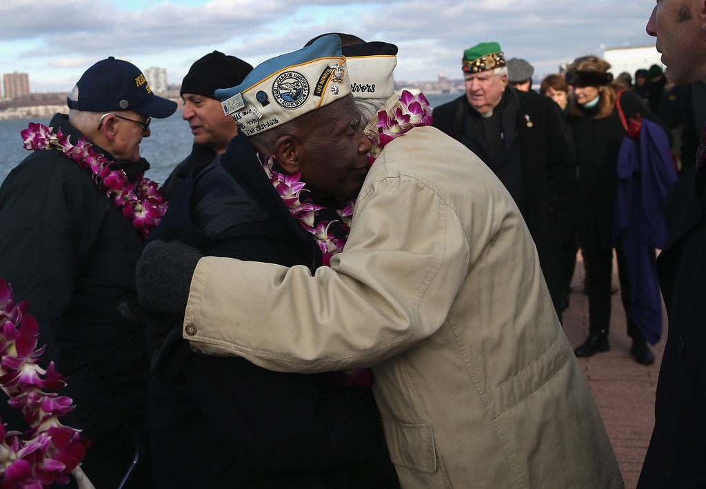 . Pearl Harbor survivors embrace at a ceremony marking the 72nd anniversary of the attack on Pearl Harbor, Hawaii on December 7, 2013 in New York City. (Photo by John Moore/Getty Images)