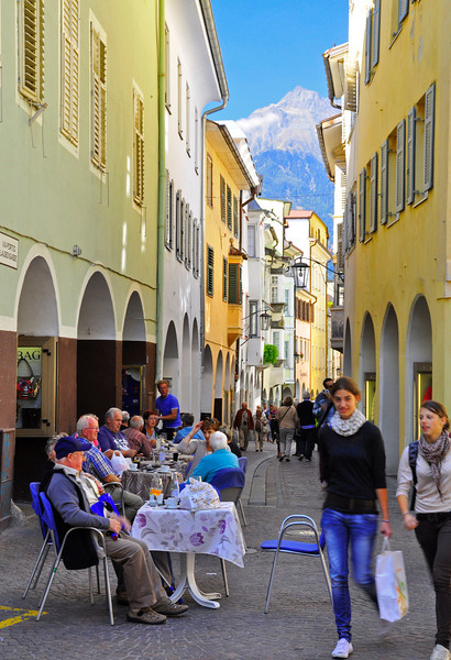busy Merano street at lunchtime
