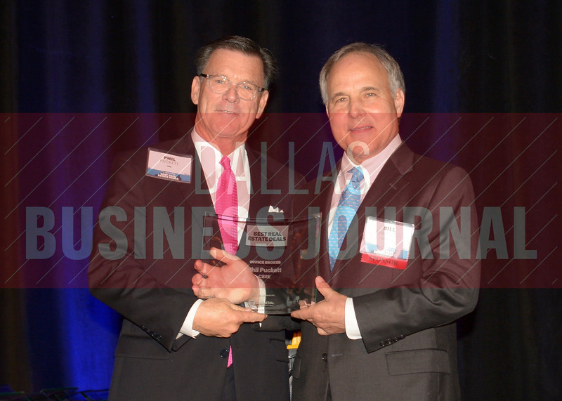 Phil Puckett, left, accepts his Office, Broker of the Year award from Bill Shaddock of Best Real Estate Deals presenting sponsor Capital Title.