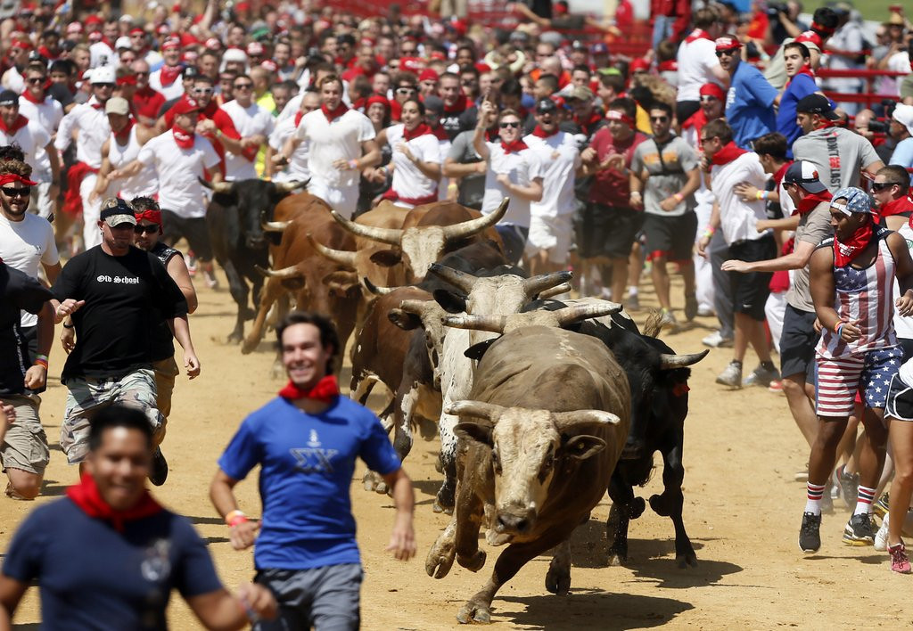 ". <p>7. (tie) RUNNING WITH BULLS  <p>At least the bulls were smart enough not to pay a $75 entry fee. (unranked) <p><b><a href=\'http://www.washingtonpost.com/local/drone-crashes-into-virginia-bull-run-crowd/2013/08/26/424e0b9e-0e00-11e3-85b6-d27422650fd5_story.html\' target=""_blank\""> HUH?</a></b> <p>    (AP Photo/Richmond Times-Dispatch, Joe Mahoney)"